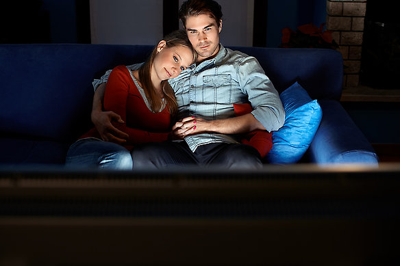 Man and Woman Watching Movie
